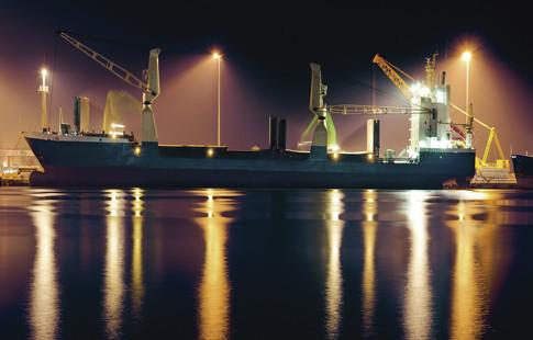 crane loading on ship image