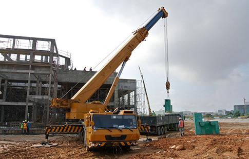 mobile crane next to building